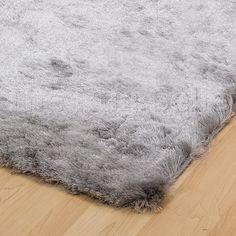 Splendour shadow rugs in silver Rug seller uk Main Bedroom by side of bed.  60 x 110cm £29.95 each