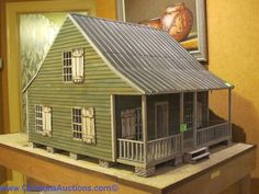 "North Carolina Cabin by Ron and April Gill, mounted on a custon made table base by Wildwood Doll House & Custom Miniatures, 1983, overall dimensions 60 x 52 x 30"" Z"