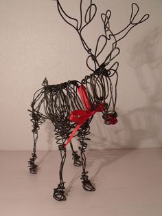 Wire reindeer sculpture. $52.00, via Etsy.