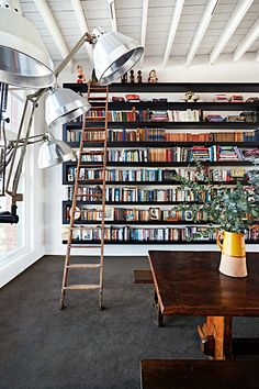 Book storage Round-up- Inspiration Floor To Ceiling Bookshelves, Warehouse Apartment, Dream Apartment, Bungalow Renovation, Home Libraries, Book Storage, Timber Flooring, Australian Homes, Industrial Lighting