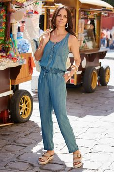Introducing the super-soft jumpsuit with a light denim look. Designed with well-played details for laidback style— partial button-front, elasticized tie waist, chest an