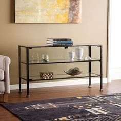 29.5 inches high x 50.75 inches wide x 16.5 inches deepThis sleek transitional console table features a black frame with silver distressing and glass panels to induce modest design, and fit well with any style décor. Display indoor gardens or showcase your memorabilia and mementos for all to see.