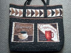 Finished this multipurpose bag with a coffee theme.  The black fabric has a coffee bean print.  The two motifs on the front are both preprinted and are both deep pockets.  There is a third pocket inside.  The flying geese are done in all browns and blacks.  The handles are long enough to go over the shoulder.  It is quilted with a meandering loop that is to mimic the swirls of steam coming off a cup of coffee. craftnut2012