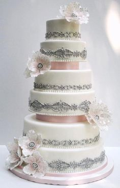 Beautiful light pink and silver cake! Maybe a different color than pink.