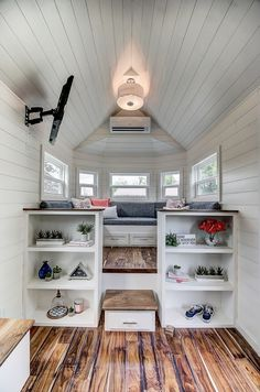 Inside the 256-square-foot house are hand scraped Acacia wood floors and white shiplap walls. The living room sits on a raised platform, which provides a large storage area under the floor.