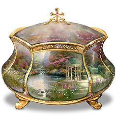 Thomas Kinkade's first-ever musical prayer box, featuring his serene Garden of Prayer artwork and available only from Ardleigh Elliott This elegant religious music box is crafted of triple-fired Heirloom Porcelain® for lustrous beauty A private compartment inside the box holds your heartfelt prayers, and a quotation from the Bible appears beneath the lid in gleaming golden script