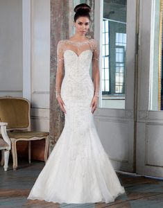 Justin Alexander signature wedding dresses style 9817  This illusion Sabrina neckline fit and flare gown features long sleeves, intricate hand beading and an illusion back. This gown possesses attitude with its opulent beadwork.