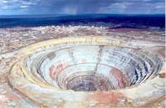 With explosions and massive machines scraping into the earth's crust like a bad case of scabies, it's small wonder open cast mining has made what many see as an unpleasant impact on the planet's surface. The face of the earth is beleaguered with giant scars, scoured out in our ongoing bid to the plunder the planet of its natural resources.
