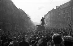 A speaker on a delivers a speech to the crowd about the rebellion against the Soviet Union Budapest 1956 Shock Wave, Austro Hungarian, Central Europe, Through The Looking Glass, Cold War, Historian, Homeland, Time Travel, World War Ii