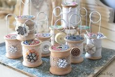 Card or picture holders made from old thread spools