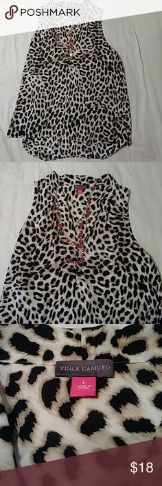 NWOT Vince Camuto Sleeveless Blouse NWOT Vince Camuto Leapord print sleeveless blouse. 100% Rayon light flowy material. Back is approximately 2 inches longer. Never worn. Great piece that can be dressed up with a black pencil skirt or dressed down with some skinny jeans and red heeels 👠 Vince Camuto Tops