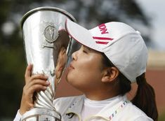 July 29, 2012    South Korea's Inbee Park poses with the trophy after winning the Evian Masters golf tournament Sunday in Evian-Les-Bains, France.