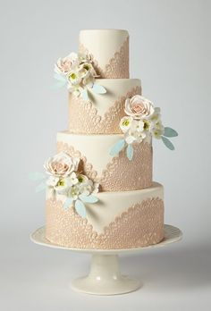 Brides.com: America's Prettiest Wedding Cakes. A Tiered Cake with Lace and Floral Accents. Go over-the-top adorbs with blush doilies and pastel sugar blossoms.   Cake by Erica OBrien Cake Design, Hamden, CT  Find a wedding cake vendor in Connecticut.