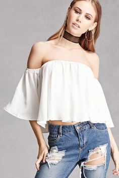 A woven textured crop top featuring an off-the-shoulder neckline, short bell sleeves, and a flowy silhouette. This is an independent brand and not a Forever 21 branded item.