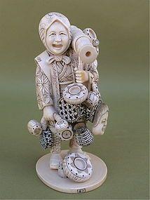 JAPANESE OKIMONO | Japanese Ivory Okimono Woman merchant by Ta Naka (item #1062042)