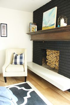 Black paint was perfect for this old outdated fireplace. This painted black…