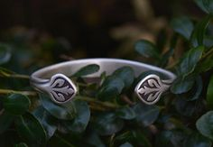 Flower Cuff Bracelet Silver - Inspired by wildflowers, this sterling silver bracelet is sure to turn heads. To add drama and contrast, our designer, Sara, hand crafts each piece with an oxidized armor-like design.