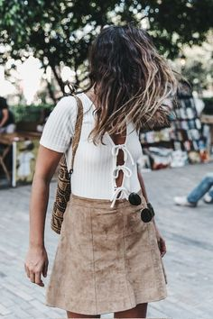 Photos via: Collage Vintage Admiring blogger Sara's modern-boho summer look. We absolutely adore her sexy triple tie-front top tucked into her suede skirt accompanied by her woven backpack and jewel e