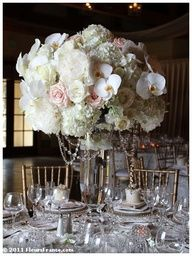 Tall wedding centerpiece in ivory  blush, with hanging crystals