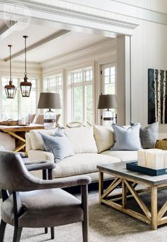 Love the neutrals, the picnic style dining table with outdoor lanterns for lighting. Lake House tour: Country casual cottage - Style At Home - Looking from kitchen into great room Chic Living Room, Home Living Room, Living Room Designs, Living Room Decor, Living Spaces Furniture, Kitchen Living, Style At Home, Ideas Hogar, Piece A Vivre