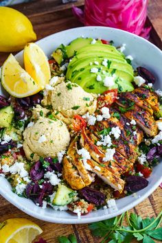 A quinoa tabbouleh salad topped with chicken shawarma in a light and tasty tahini dressing!