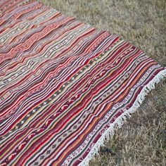 Red Turkish Kilim Rug | Birch & Brass Vintage Rentals | Weddings and Corporate Events | Austin, Texas