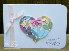 I wanted to make apretty birthday card made up of hearts and this is what I came up with ... I drew a freehand heart shape onto some whisper white card and cut it out. Using all the heart punches...