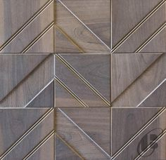CHEVRON from Jamie Beckwith Collection. Comes as individual square engineered hardwood tiles suitable for wall and ceiling applications. Manufactured in Nashville, TN.