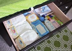 "I love that all the diaper necessities are hidden in a drawer and that there is plenty of room for all this clothes, the clothes in the next size up and his blankets, burp rags, little hats, swaddles and basically all his ""swag"" 🙂 Changing Table Dresser, Burp Rags, Office Furniture, Drawers, Lunch Box, Living Room, Storage, Blankets, Swag"