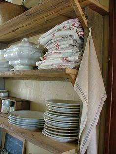 rustic wood with white dishes... and love that stack of red striped towels