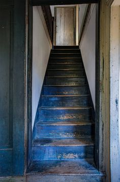 The original stairs ascend from the central front hall, that neatly divides the house.