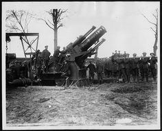 A howitzer, fondly known as 'Granny', being set up. The gun is surrounded by soldiers, most of whom appear to be involved in the preparation...