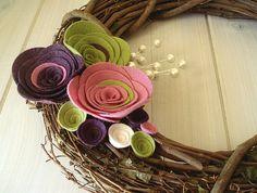Grapevine wreath with felt flowers.
