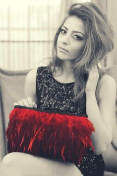 Vibrant red feathers trimmed with black guipure handbag