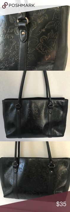 """Franklin Covey • Leather Embossed Tote Bag Excellent used condition. Black leather embossed Tote with silver hardware. 3 compartments (middle zips). Interior has 3 pockets (1 zips). 2 pen holders. Strap drop is approximately 11"""". Franklin Covey Bags Totes"""