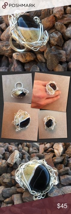 "Agate Lovely Stone Ring A beautiful black tan and white agate stone entwined in hand formed silver. One of a kind hand formed creation by Xcelnt Dzine. Show stopper that will dazzle any thing you're wearing. Be unique! Any markings and the unique free form style come from being hand made. Approx 1"" circumference width 1 1/2"". mark down! Hand Made Xcelnt Dezine Jewelry Rings"
