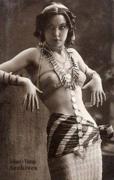 No information on her. Great old vintage belly dancer photo.