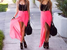 Hot pink high low skirt paired with simple black tank and scrappy sandals