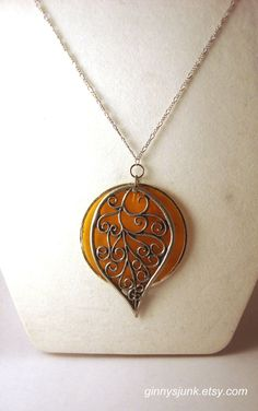 Orange Shell with Silver Leaf Pendant Necklace - Fall Jewelry - Silver Filigree Leaf - 16 Inch Chain. $12.50, via Etsy.