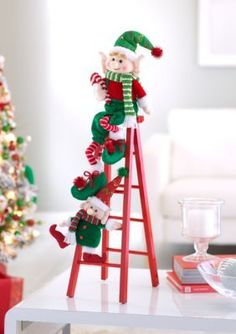 This fun elf ladder is the perfect festive touch for any room in your home. It has a nonfunctional ladder, so should not be considered a toy. Christmas Flowers, Christmas Wreaths, Christmas Crafts, Christmas Ornaments, Christmas Gingerbread Men, Simple Christmas, Christmas Holidays, Elf Christmas Decorations, Coastal Christmas