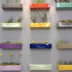 These glossy ceramic wall bricks are a really fun idea and look great mounted on a wall. Wall art and practical vase in one!