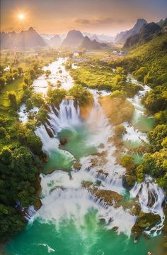 An aerial view that showcases the grandness of the waterfall (Cao Bằng Province). Bản Giốc is the 4th largest waterfall that lies along a national border in the world (Photo by Vũ Phi Long - tcdulichtphcm.vn)