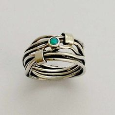Sterling silver unisex wrapped ring with blue opal - Love of my life. $96.00, via Etsy.