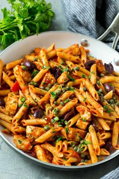This Classic Chicken Pasta Puttanesca recipe is made with olives, capers, whole wheat pasta and sautéed chicken. Easy to make Puttanesca recipe. Healthy Chicken Pasta, Chicken Pasta Recipes, Healthy Pasta Recipes, Healthy Pastas, Recipe Chicken, Meat Recipes, Pasta Puttanesca, Louisiana Chicken Pasta, Dining