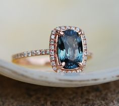 Blue Green sapphire Rose gold engagement ring. Engagement ring by Eidelprecious. This ring features a 1.7ct cushion sapphire. The color is gorgeous