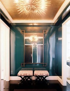 Glam foyer with peacock lacquered walls and gold leaf ceiling. Designer: Lilly Bunn Weekes, Photographer: Patrick Cline