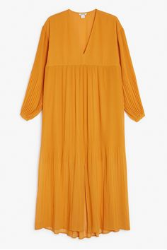A dazzling oversized medi-evil/maxi-awesome princess-meets-the-city-streets kind of dress. Featuring a front slit, V-neck and romantic sleeves that gather at the wrist. All in a pleated and floaty sheer fabric. colour: Monarch orange In a size small the chest width is 104 cm and the length is 91 cm. The model is 175 cm and is wearing a size small.