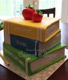 Stack Of Books Teacher Graduation Cake Stack Of Books Teacher Graduation Cake This is a cake I made for 2 Teachers that just graduated. Top is chocolate cake with chocolate... #featured-cakes #alyssac #leannew #cakecentral