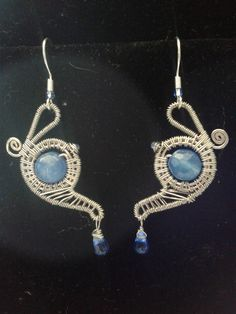 Silver wire-wrapped teapot earrings accented with blue crystal and blue glass drop beads!