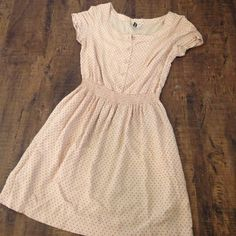 Vintage Styled Polka Dot Dress Cute lightweight dress in beige with little pink polka dots. Button front and elastic waist with POCKETS! EU size 34 is equivalent of ladies 6. Will comfortably fit sizes 2-4. Divided by H&M. Cute vintage look.  FIRM UNLESS BUNDLED Divided Dresses Mini